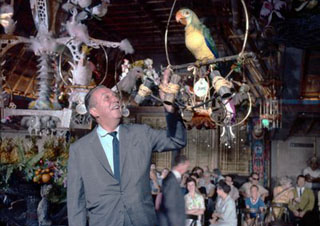Walt in the Tiki Room with an animatronics parrot