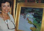 Jeanette Legrue and her painting Lillies Thumbnail