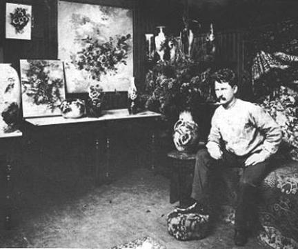 Photo Franz Bischoff in studio with paintings of roses
