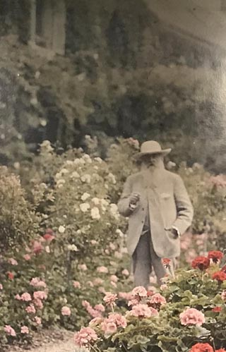 Claude Monet in his garden at Giverny, Wall mural photo welcomes you to Monet: The Late Years at the de Young Museum