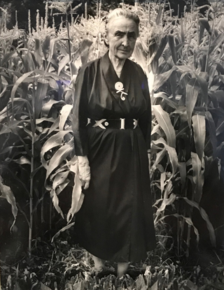 Georgia O'Keeffe in Abiquiu,Garden in Front of Corn Todd Webb, no date given